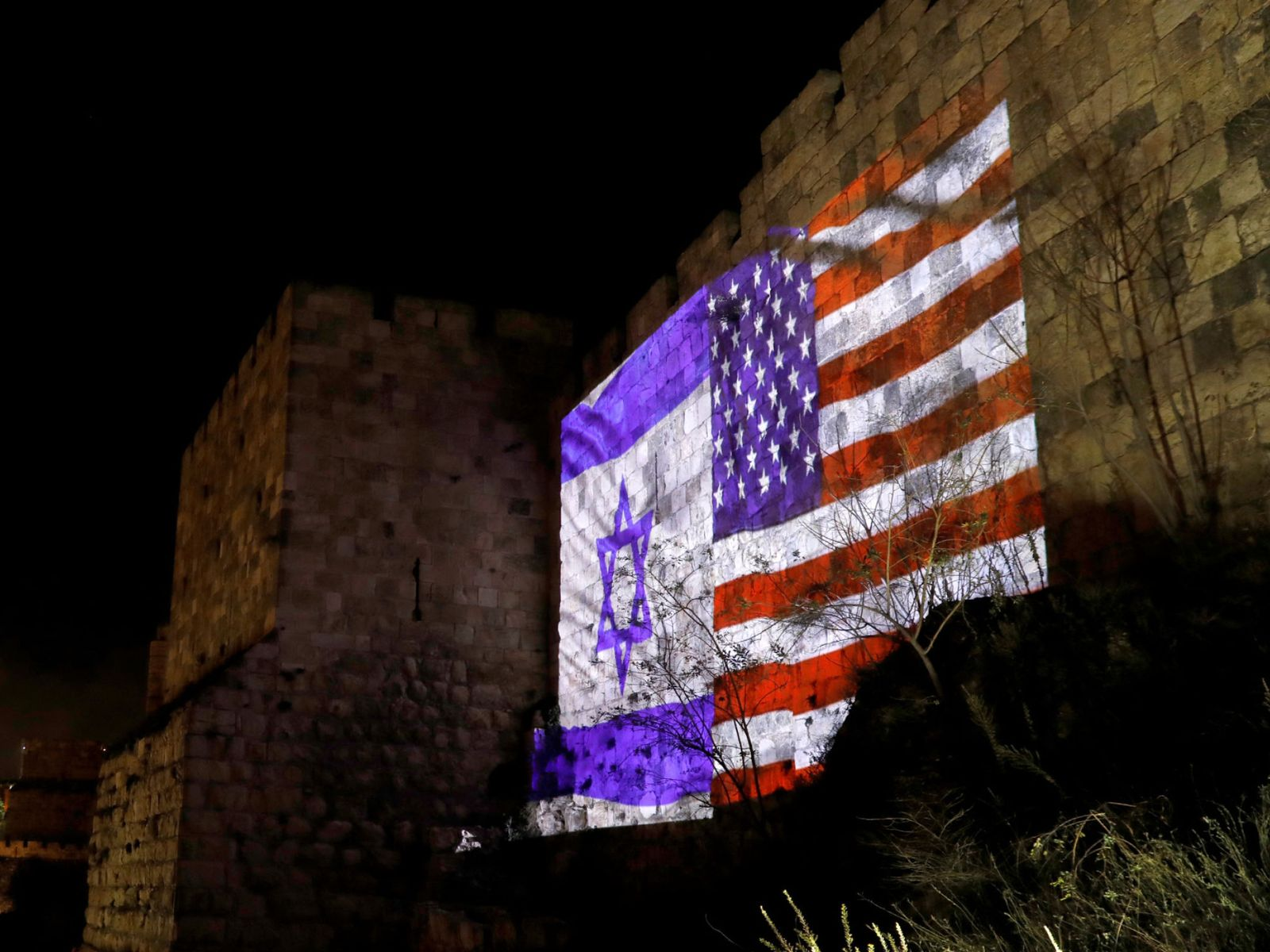 Israeli and American flags are projected on a part of the walls surrounding Jerusalem's Old City
